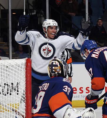 Photograph - Winnipeg Jets V New York Islanders by Bruce Bennett