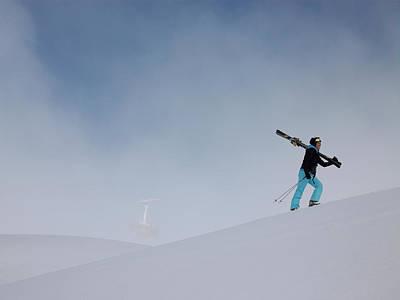 Ski Photograph - Woman Carrying Skis Walking Up Snow by Mel Yates