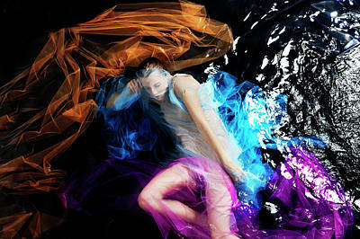 Photograph - Woman Floating In Water With Colored by Tara Moore