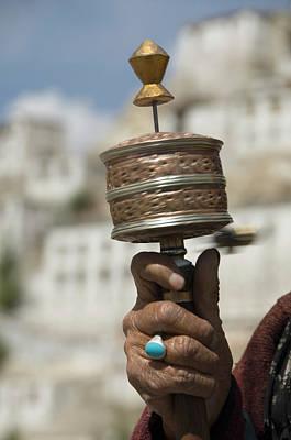 Photograph - Woman Holding A Prayer Wheel, Ladakh by Exotica.im