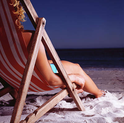 Photograph - Woman In Deck Chair On Beach, Close Up by Kelvin Murray