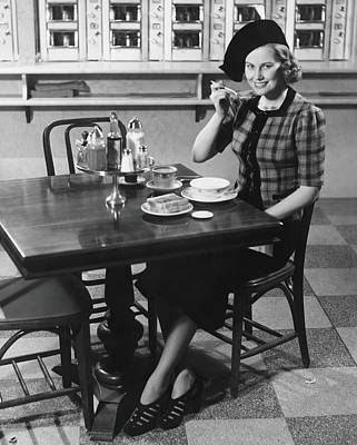 Photograph - Woman In Fancy Hat Eating Breakfast In by George Marks