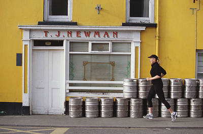 Pub Photograph - Woman Jogging Past Pub, Side View by Tracy Frankel