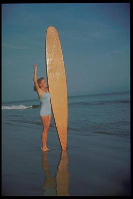 Holding Photograph - Woman On Beach With Wooden Surfboard by Archive Holdings Inc.