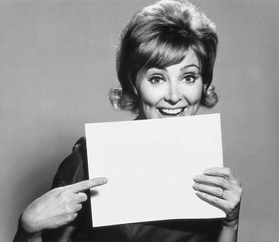 Holding Photograph - Woman Pointing To A Blank Sheet Of Paper by Archive Holdings Inc.