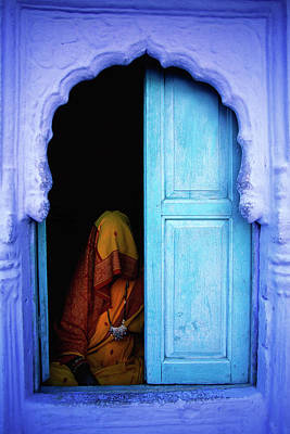Photograph - Woman Sitting Near Blue Door by Dave Rawlinson