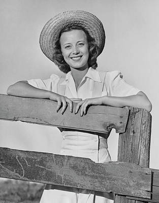 Photograph - Woman Smiling While Leaning On A Wooden by George Marks