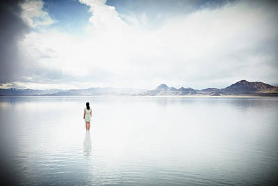Photograph - Woman Standing In Shallow Water Looking by Thomas Barwick