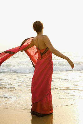 Indian Culture Photograph - Woman Standing On Beach, India by Jupiterimages