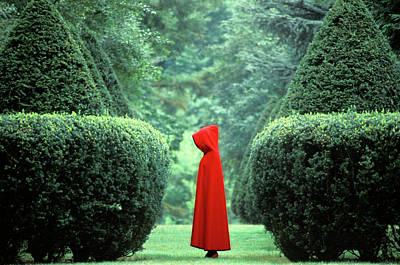 Photograph - Woman Wearing Red Cape Among Hedges by Nancy Brown