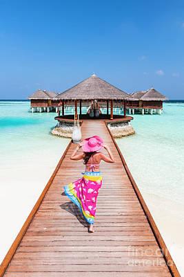 Photograph - Woman With Sarong Walking On Jetty, Maldives by Matteo Colombo