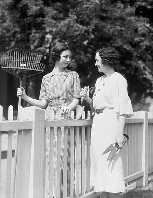 Women Chatting Over Fence Art Print by H. Armstrong Roberts
