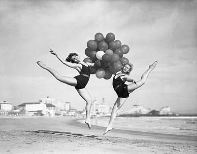 Photograph - Women Doing Balloon Dance On Beach by Bettmann