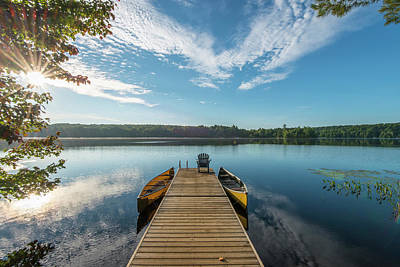 Photograph - Wooden Pier Reaches Into Tranquil Lake by Ascent Xmedia