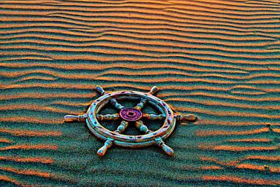 Photograph - Wooden Ships Wheel On Wavey Sand by Garry Gay