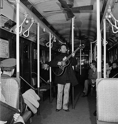 Photograph - Woody Guthrie Performs In Subway Car by Eric Schaal
