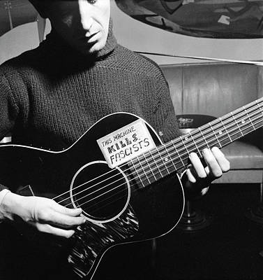 Photograph - Woody Guthrie Playing Guitar by Eric Schaal