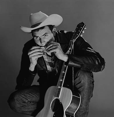 Photograph - Young Country Musician Playing Harmonica by Superstock