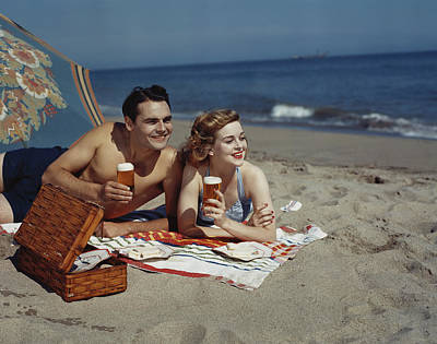 Photograph - Young Couple Lying On Beach With Beer by Tom Kelley Archive