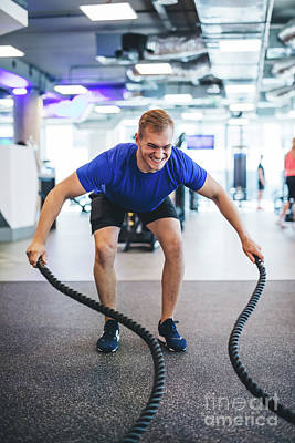 Photograph - Young Man Exercising With Ropes At The Gym. by Michal Bednarek