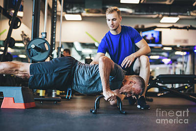 Photograph - Young Man Helping Senior Man In A Workout. by Michal Bednarek