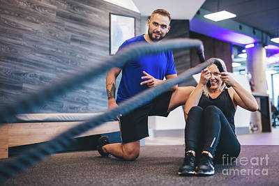 Photograph - Young Woman Exercising With Personal Trainer At The Gym. by Michal Bednarek