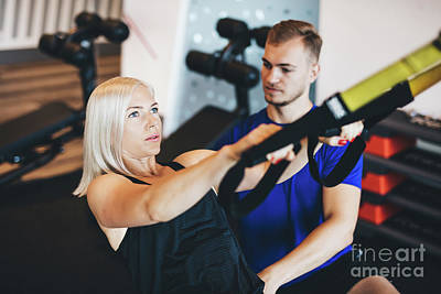Photograph - Young Woman Exercising With Personal Trainer. by Michal Bednarek