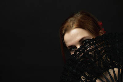 Bringing The Outdoors In - Young woman hiding face by a crochet black hand fan by Jaroslav Frank