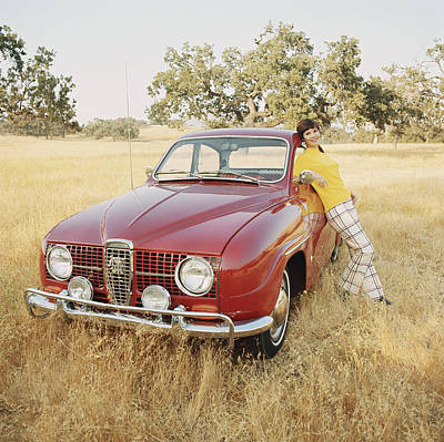 Photograph - Young Woman Leaning Against Vintage Car by Tom Kelley Archive