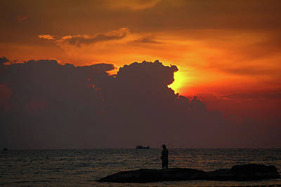 Pop Art Rights Managed Images - A silhouette of fishermen standing on rocks at sunset at Ba Keo Beach Royalty-Free Image by Snap-T Photography