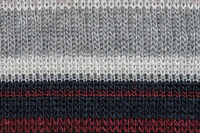 Curated Travel Chargers - Black and grey knitting wool with red and white stripes texture background.  by Julien