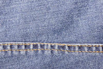 School Teaching - Blue jeans sew closeup texture.  by Julien