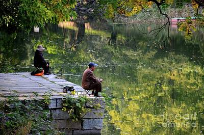 Abstract Stripe Patterns - Couple sit quietly on jetty and fish at a lake outside Beijing China by Imran Ahmed