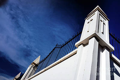 Thomas Kinkade Royalty Free Images - High white concrete walls with metal bars separate the dead from Royalty-Free Image by Joaquin Corbalan