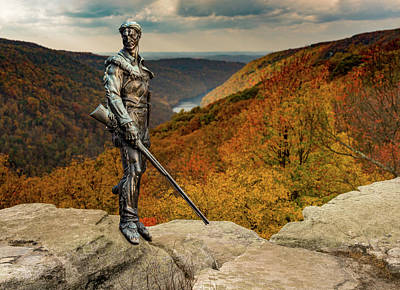 Photograph - Mountaineer statue from WVU with fall leaves in West Virginia by Steven Heap