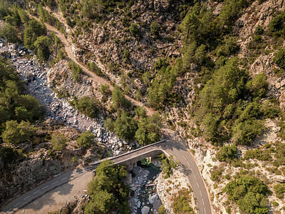 Photograph - Road and bridge over mountain stream in Corsica by Jon Ingall