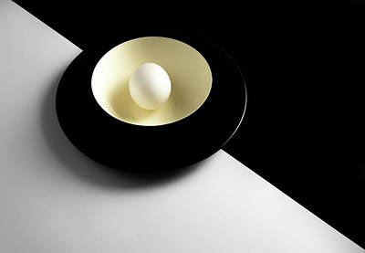 Photograph - Single fresh white egg on a yellow bowl by Michalakis Ppalis
