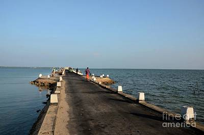 Design Turnpike Books - Sri Lankans walk on a causeway road out towards a jetty in water Jaffna Sri Lanka by Imran Ahmed