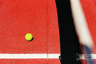Sports Royalty-Free and Rights-Managed Images - Yellow tennis ball on the red cement court to the sun, summer sp by Joaquin Corbalan