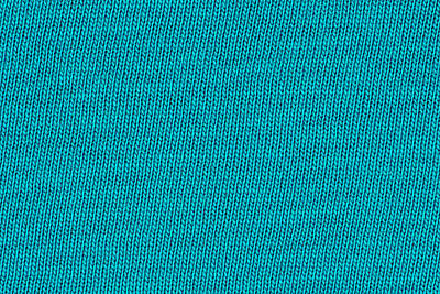 Royalty-Free and Rights-Managed Images - Blue knitting wool texture closeup photo background.  by Julien