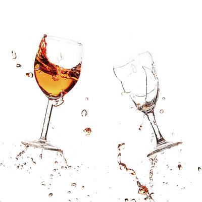 Rabbit Marcus The Great - Red wine in glasses with splashes on a white background isolated by Michalakis Ppalis