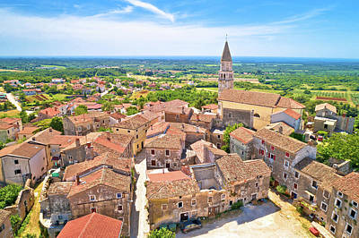 Curated Travel Chargers - Istria. Town of Visnjan on green istrian hill aerial view by Brch Photography