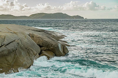 Bath Time Rights Managed Images - Mediterranean sea crashing into rocks and Genoese tower Royalty-Free Image by Jon Ingall