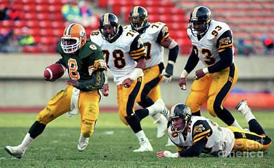Sports Royalty-Free and Rights-Managed Images - Edmonton Eskimos Football - Tracy Ham - 1990 by Terry Elniski