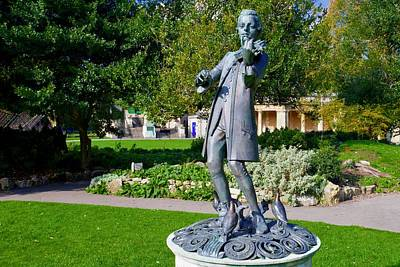 Superhero Ice Pop - A bronze statue of Amadeus Mozart playing a violin in The Parade Gardens, Bath, Somerset, England. by Joe Vella