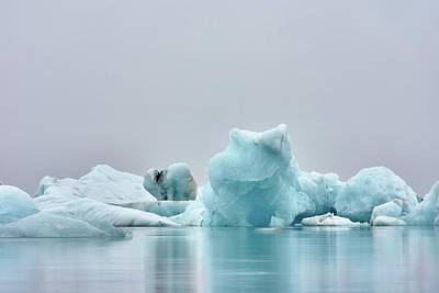 Royalty-Free and Rights-Managed Images - a shot I like a lot from a very miserable rainy day - ice figure near body of water - Unnamed Road, Iceland by Julien