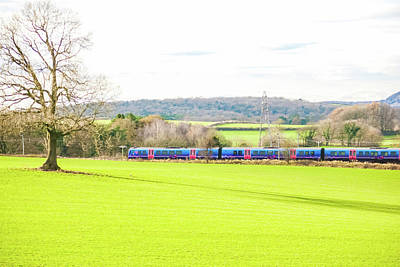 Royalty-Free and Rights-Managed Images - A TransPennine Express passenger train in the countryside UK by David Ridley