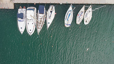 Truck Art Rights Managed Images - Aerial top down picture of yachts anchored in port. Royalty-Free Image by Michael Dechev