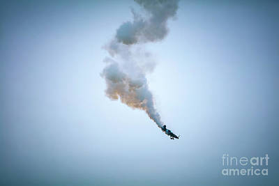 Gaugin Rights Managed Images - Airplane falling down with smoke getting from engine. Airshow. Royalty-Free Image by Michal Bednarek