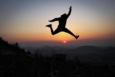 Sports Royalty-Free and Rights-Managed Images - Athlete jump over sun by Vaclav Sonnek
